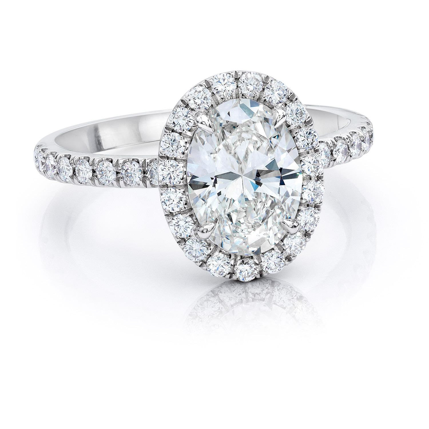 Oval Cut Diamond In Halo Solitaire Ring In Platinum